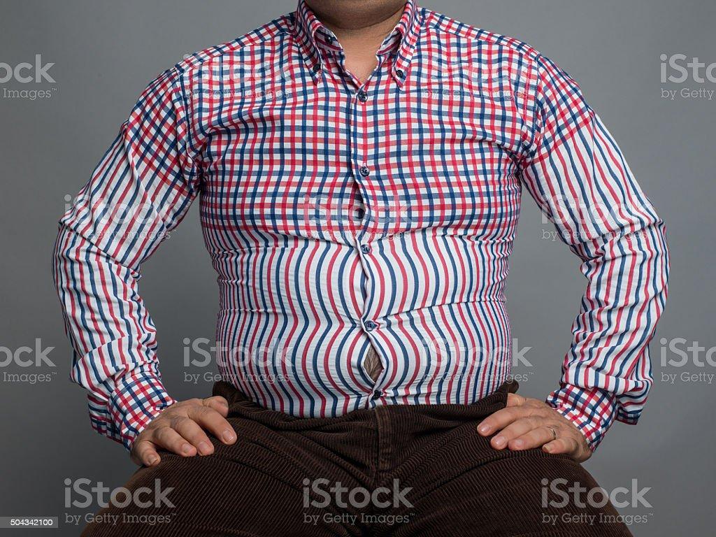 Overweight man sitting stock photo