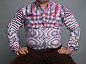 Overweight man sitting
