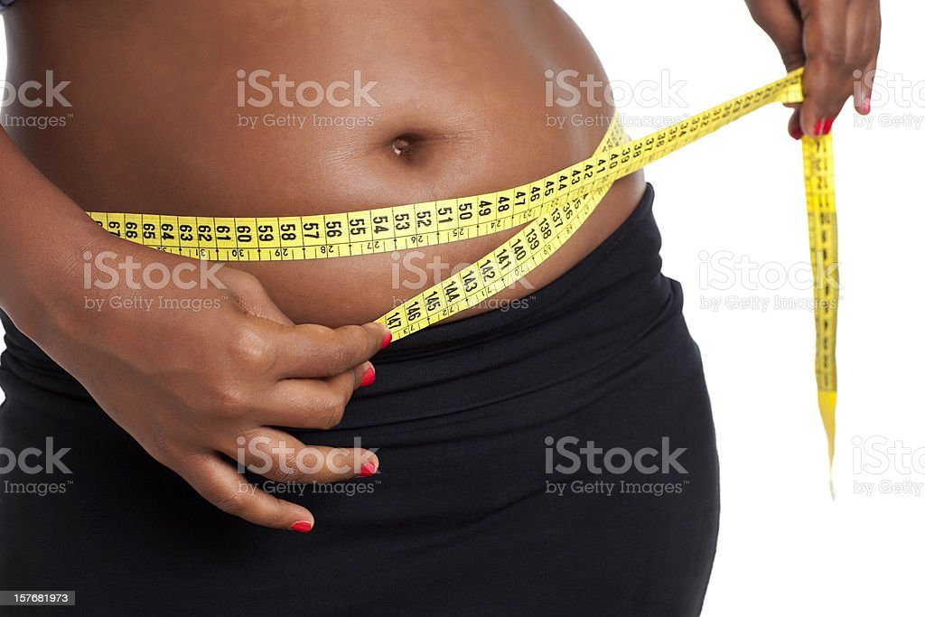 Overweight measuring royalty-free stock photo