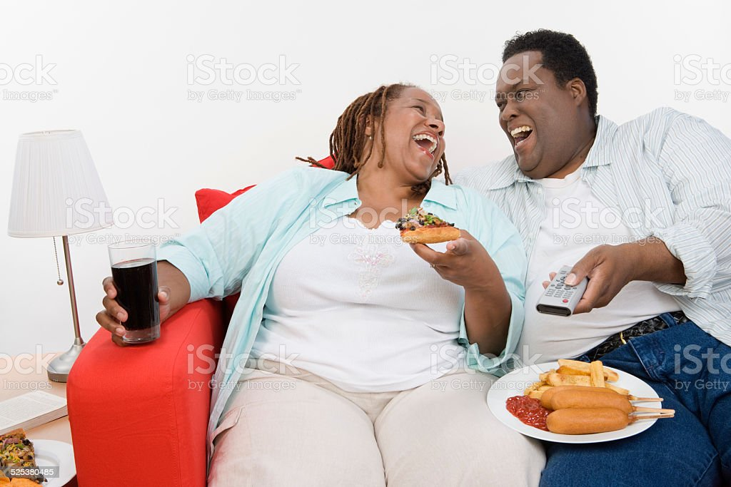 Overweight mid-adult couple stock photo