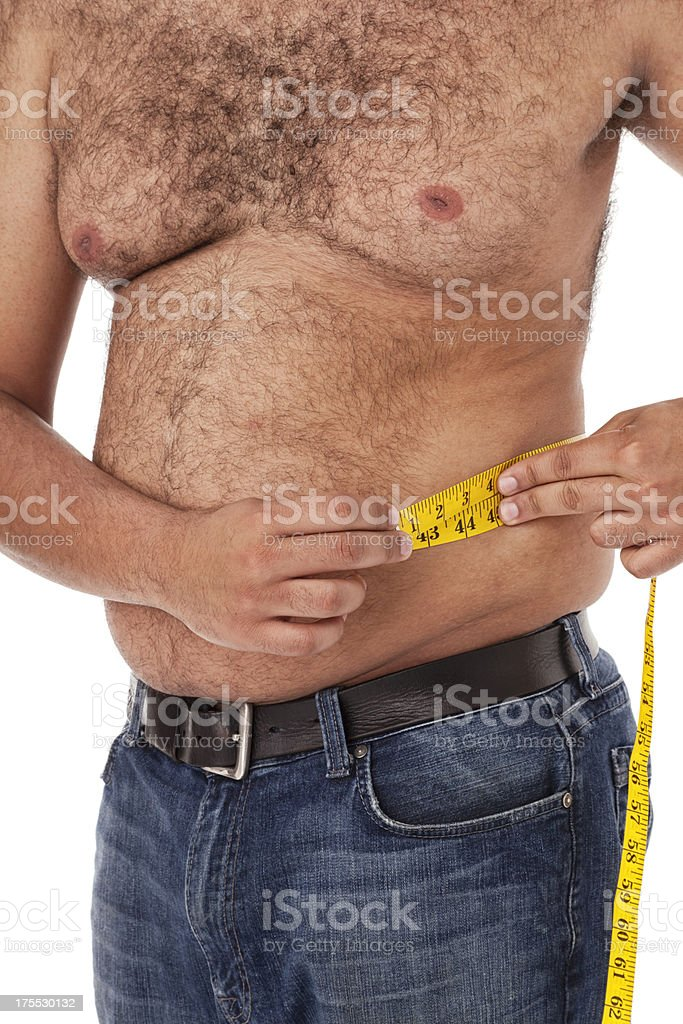 Overweight Mixed Race Man Measuring Mid Section royalty-free stock photo