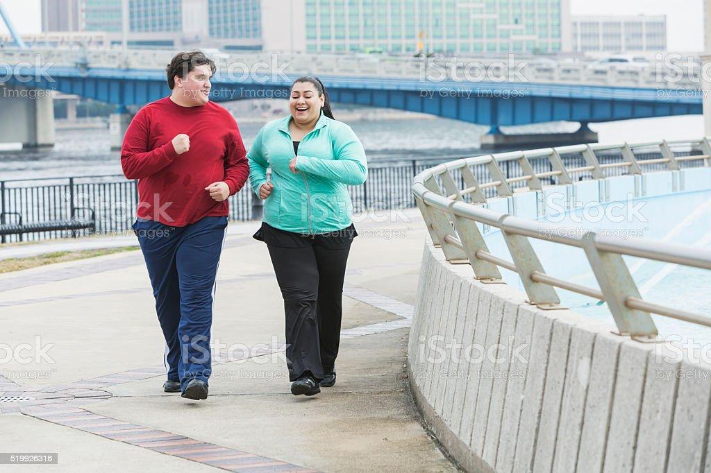 Overweight people exercising, walking, talking stock photo
