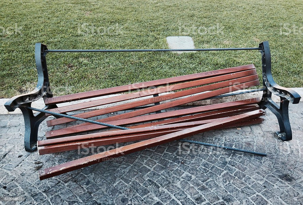 Overweight problem: broken park bench! stock photo