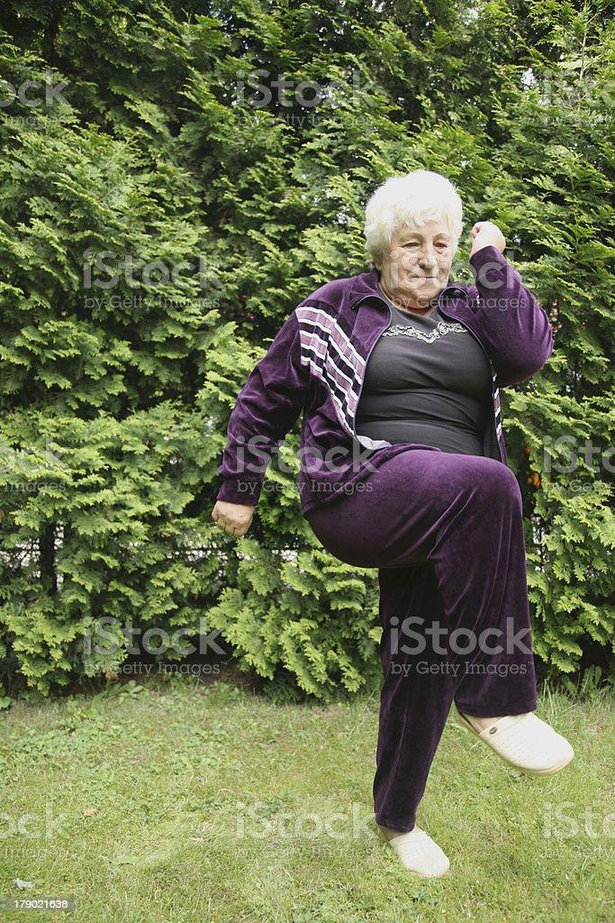 overweight senior woman exercising royalty-free stock photo