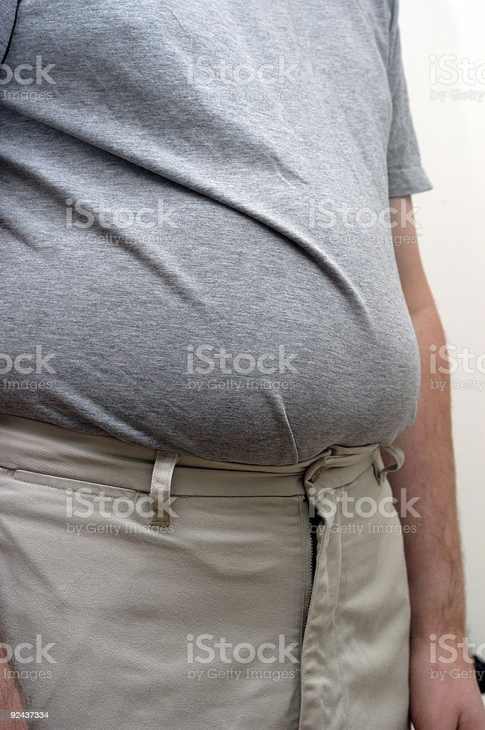 overweight stomach bulging over khaki trousers royalty-free stock photo