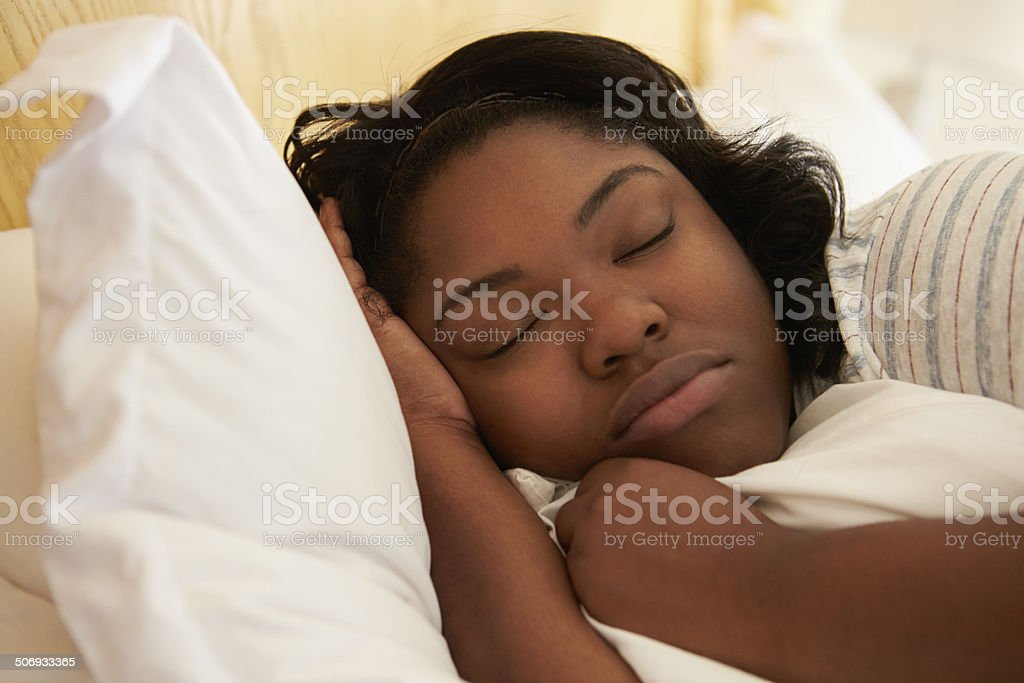 Overweight Woman Asleep In Bed stock photo