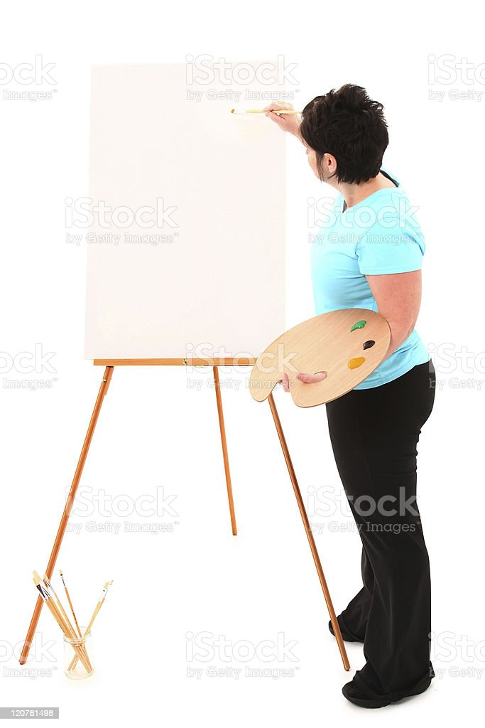 Overweight Woman at Easel Painting with Clipping Path royalty-free stock photo