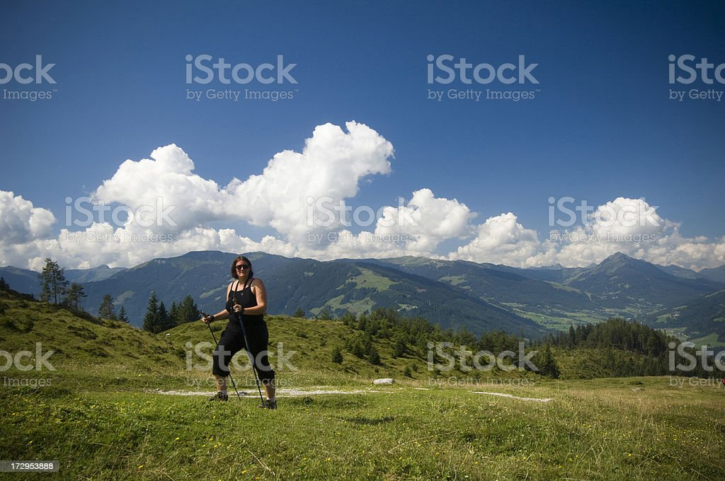 Overweight woman hikinin in the austrian alps. royalty-free stock photo