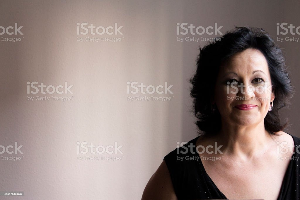 Overweight woman smiling middle-aged stock photo