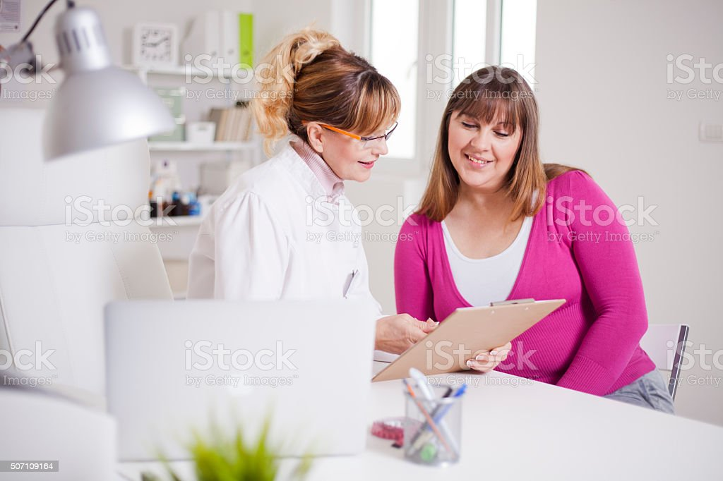 Overweight women at nutritionist's office stock photo