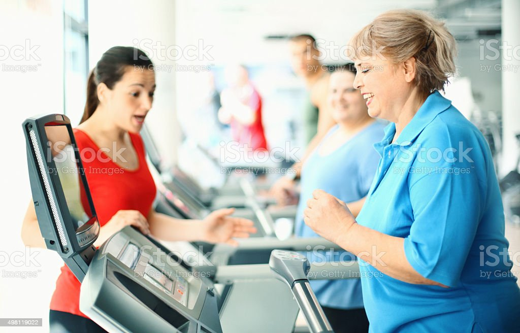 Overweight women exercising on a treadmill. stock photo