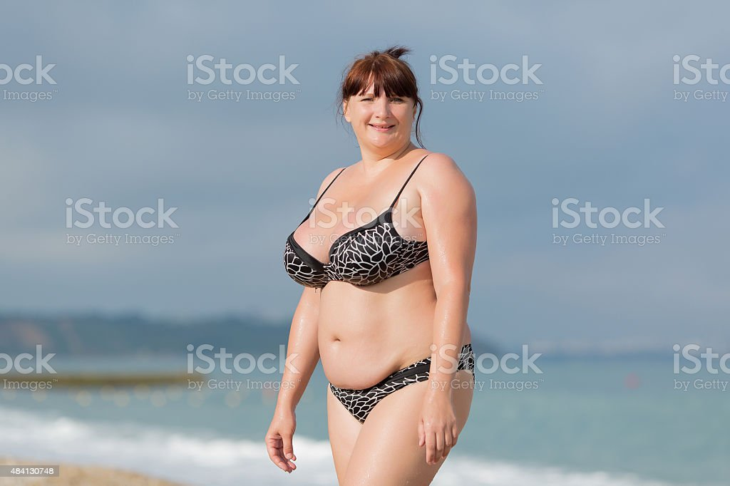 Overweight young woman at the sea stock photo