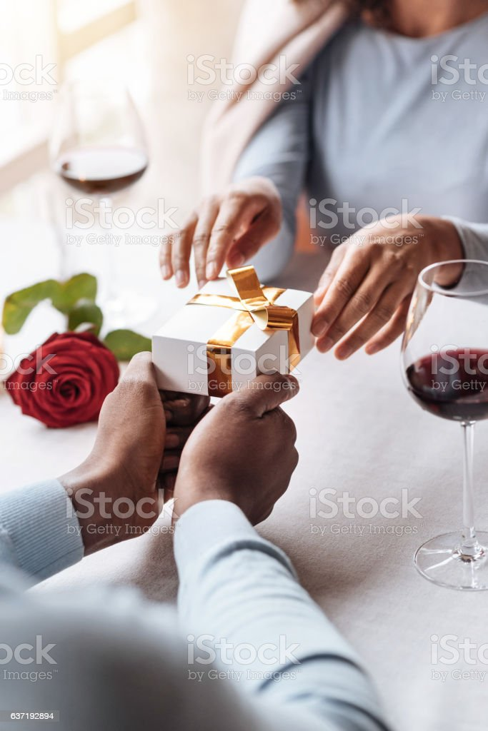 Overwhelmed African American woman getting the present stock photo