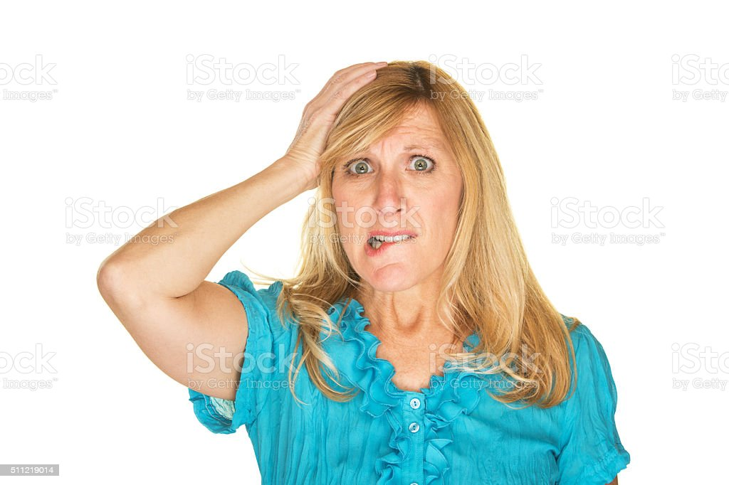 Overwhelmed Lady Biting Lip stock photo