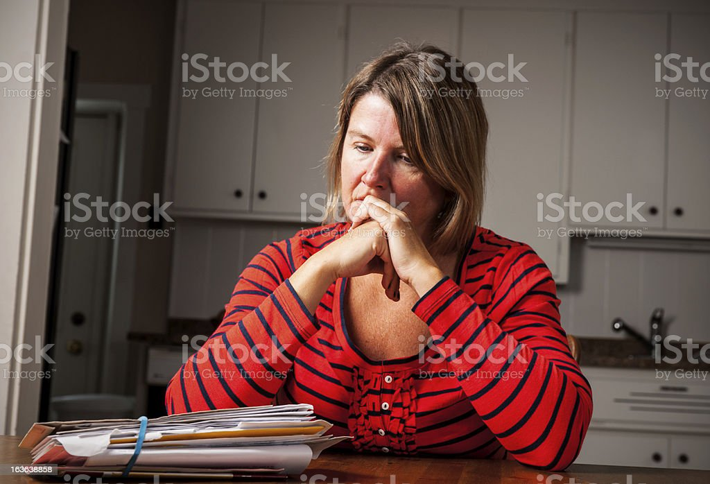 Overwhelmed with bills and debt. stock photo