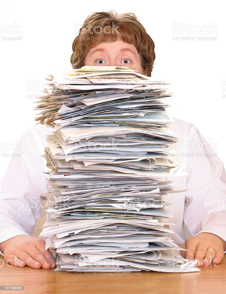 Overwhelmed with Paperwork stock photo