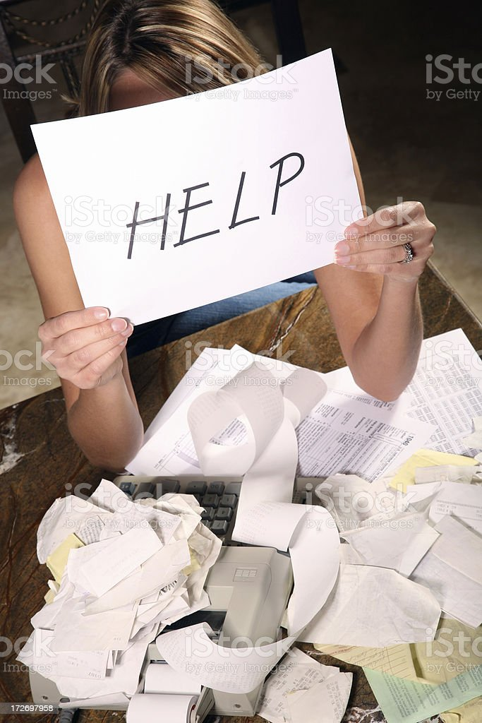 Overwhelmed Woman needs HELP with Budget and Taxes stock photo