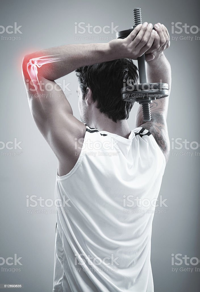 Overwork can cause injury stock photo