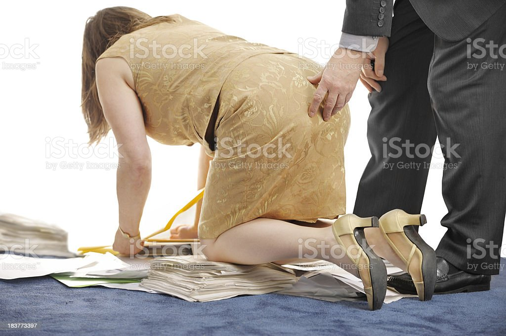 Overworked and sexually harrassed woman stock photo
