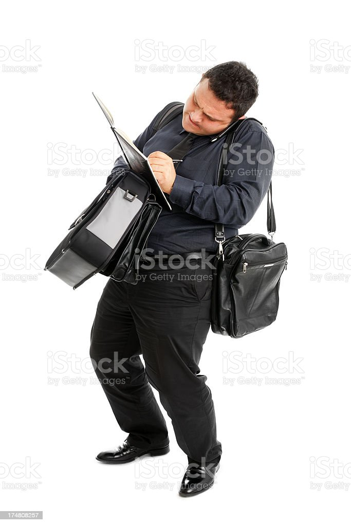 Overworked Business Man Jotting talking on the smart phone royalty-free stock photo