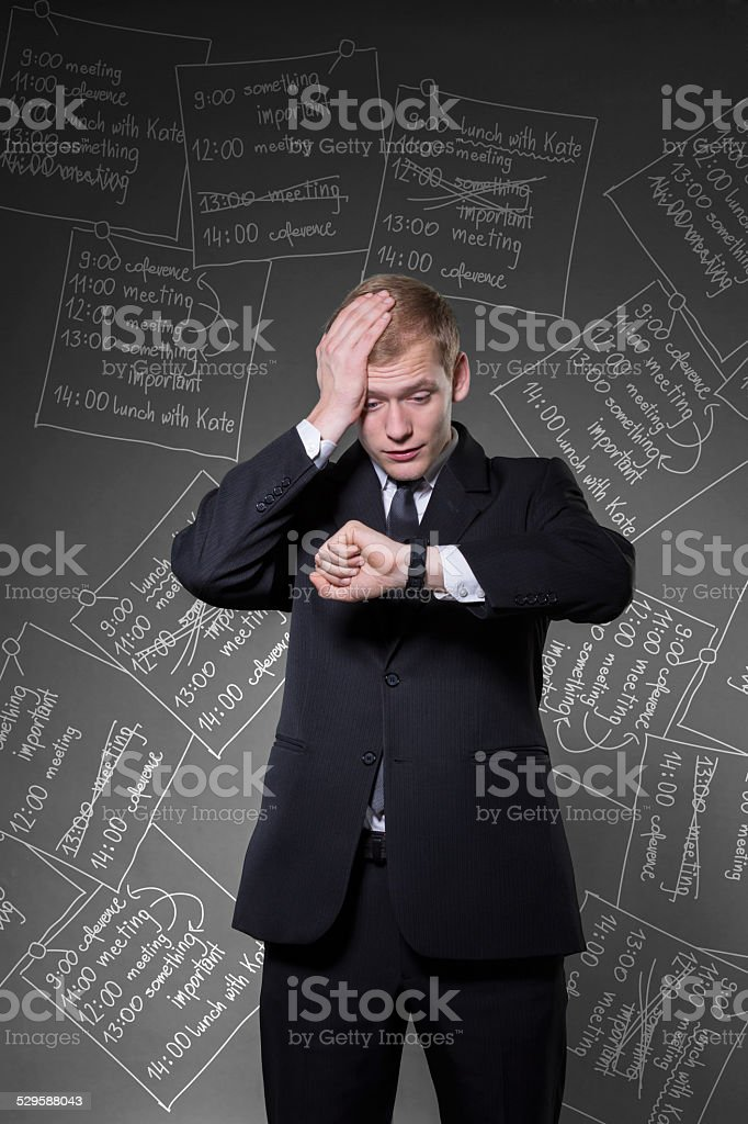 Overworked businessman being late stock photo