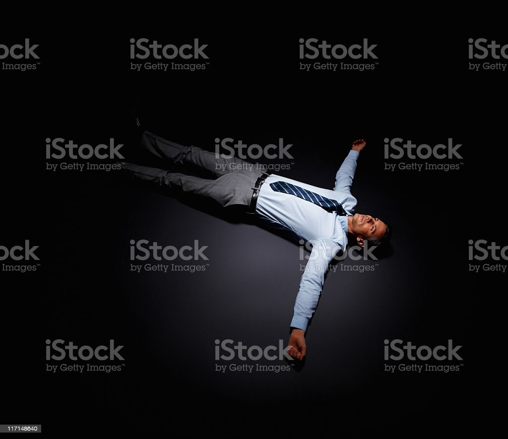 Overworked businessman lying down royalty-free stock photo