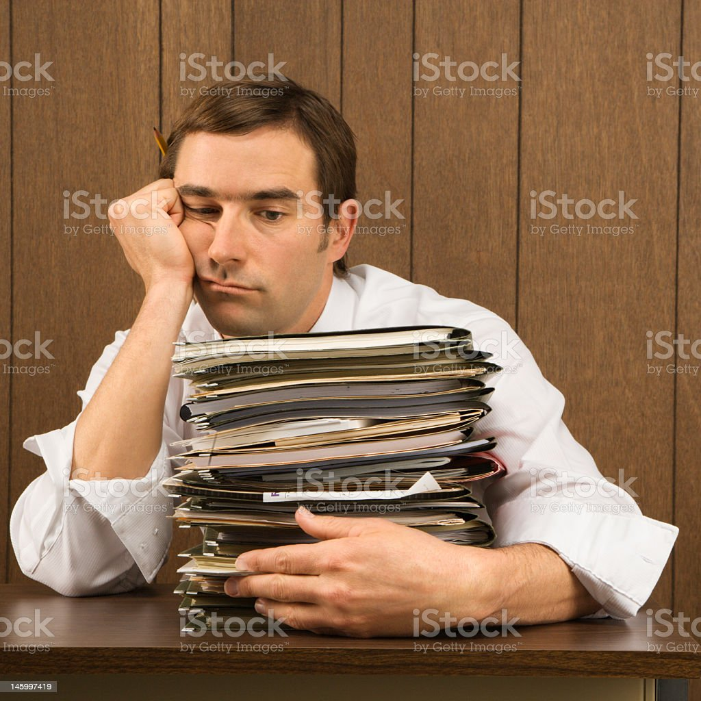 Overworked businessman. stock photo
