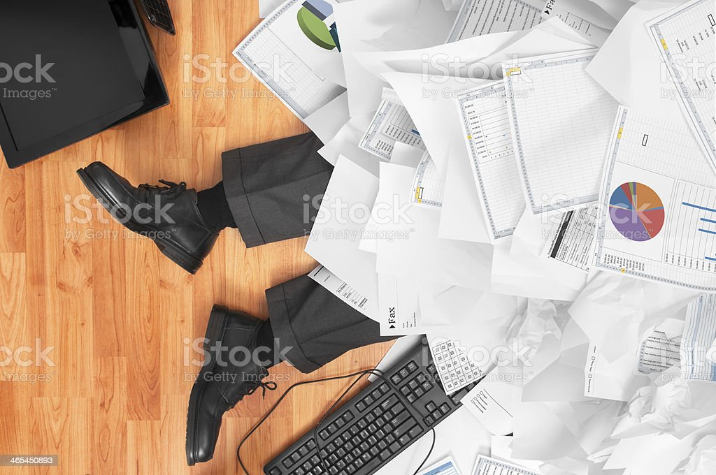 Overworked Businessman stock photo