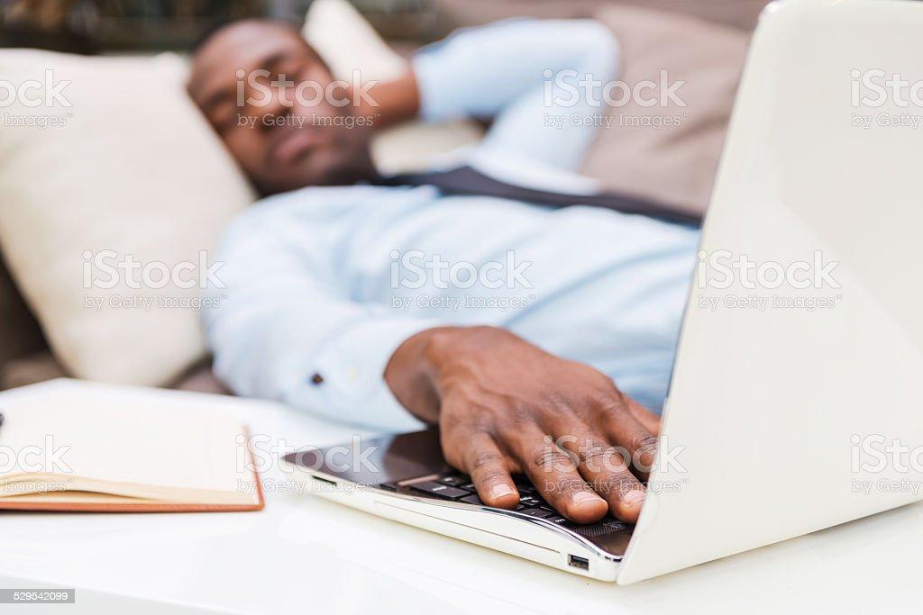 Overworked businessman. stock photo