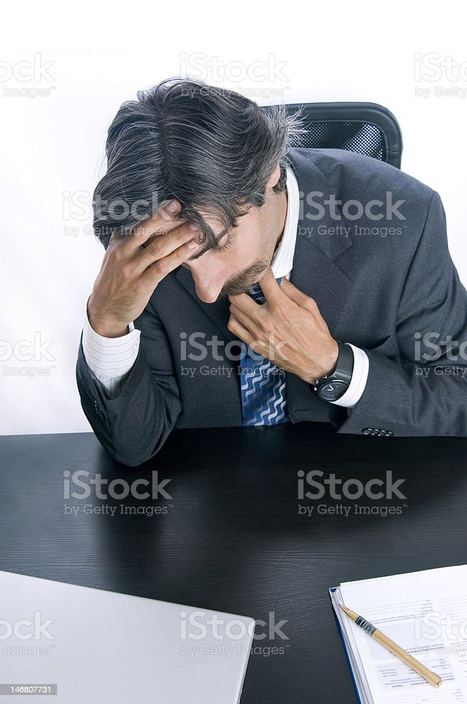 Overworked Businessman Taking a Moment to Destress royalty-free stock photo