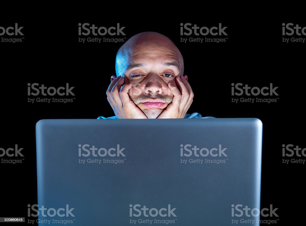 overworked businessman working on computer laptop late night  exhausted stock photo