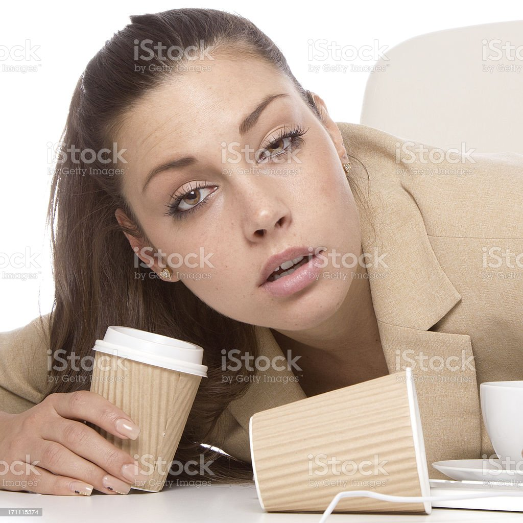 Overworked Businesswoman almost asleep royalty-free stock photo