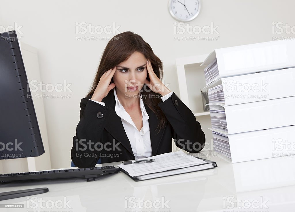 Overworked Businesswoman In Office royalty-free stock photo