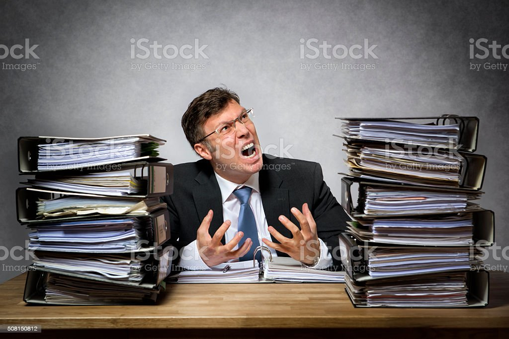 Overworked crying businessman stock photo