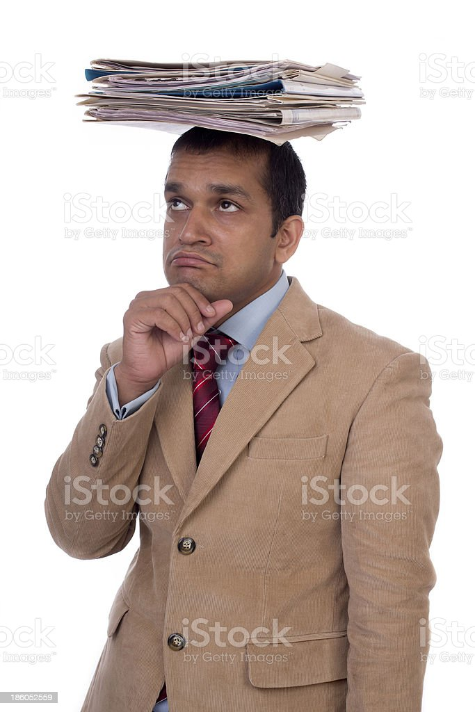 Overworked Indian businessman displaying Expressions of despair, boredom and burnout. royalty-free stock photo