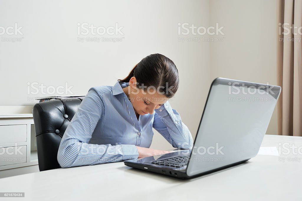 Overworked office employee stock photo