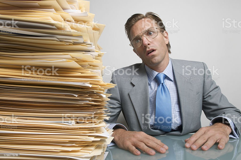 Overworked Office Worker Businessman Looking Dazed at Desk royalty-free stock photo