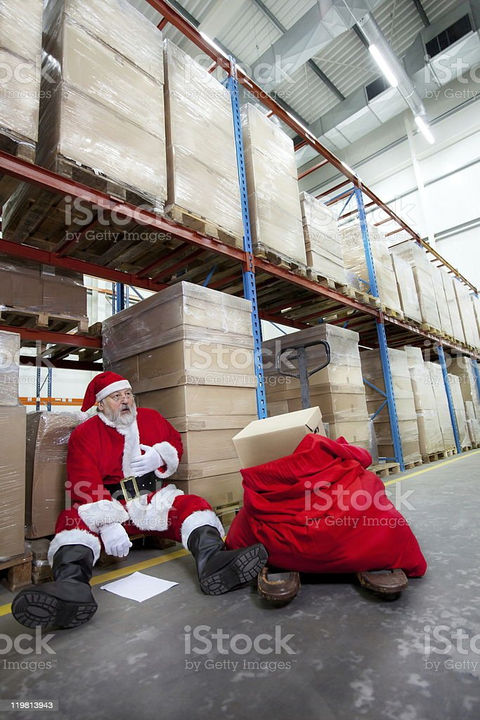 Overworked santa claus with pain in chest royalty-free stock photo