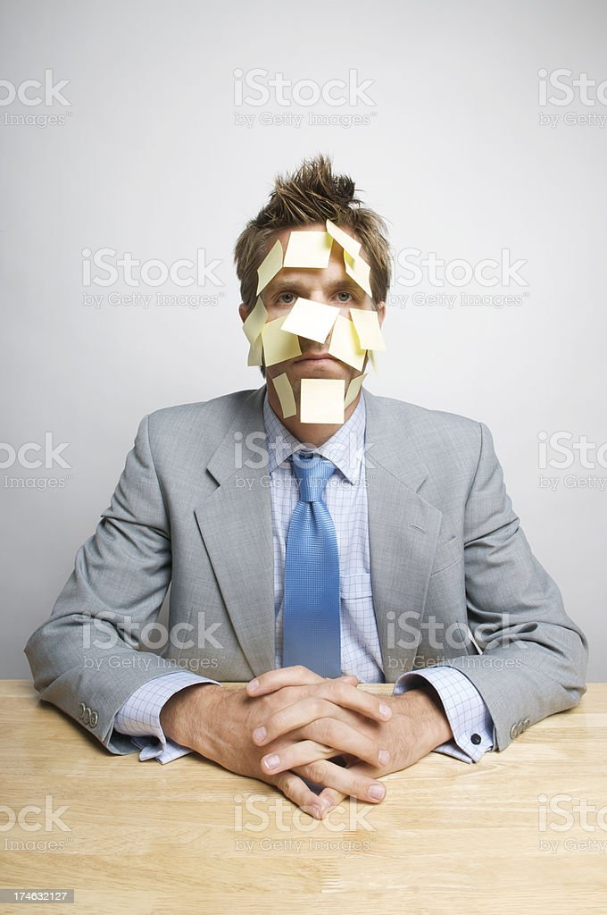 Overworked Sticky Notes Face Businessman Office Worker Sitting at Desk royalty-free stock photo