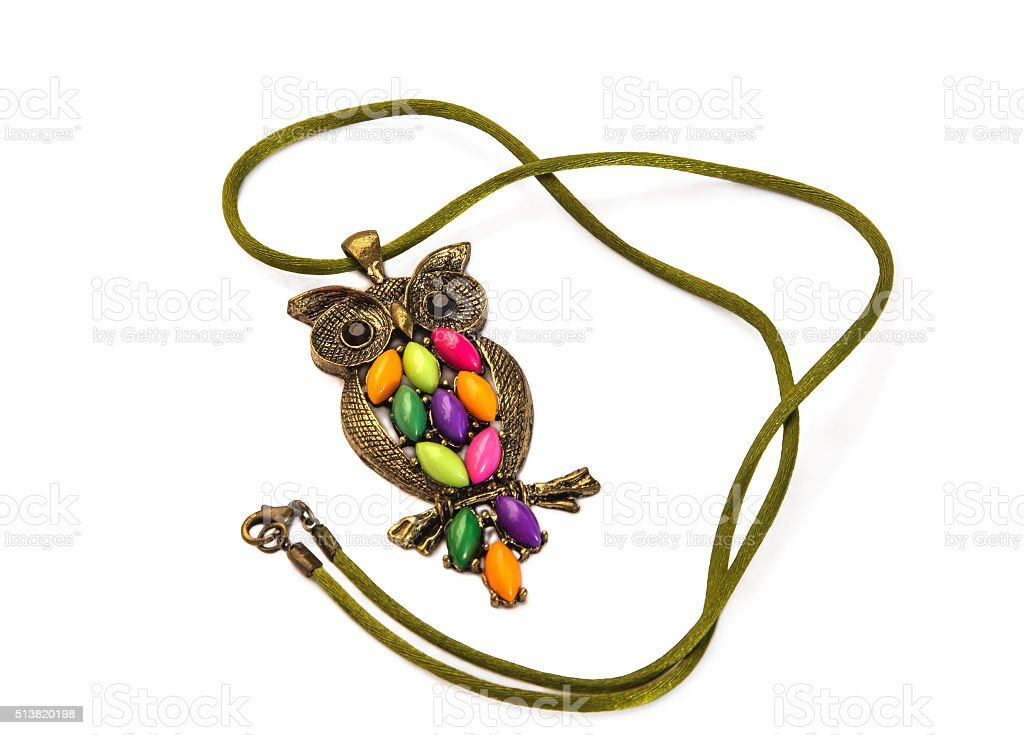 Owl necklace with coloured stones on white. stock photo