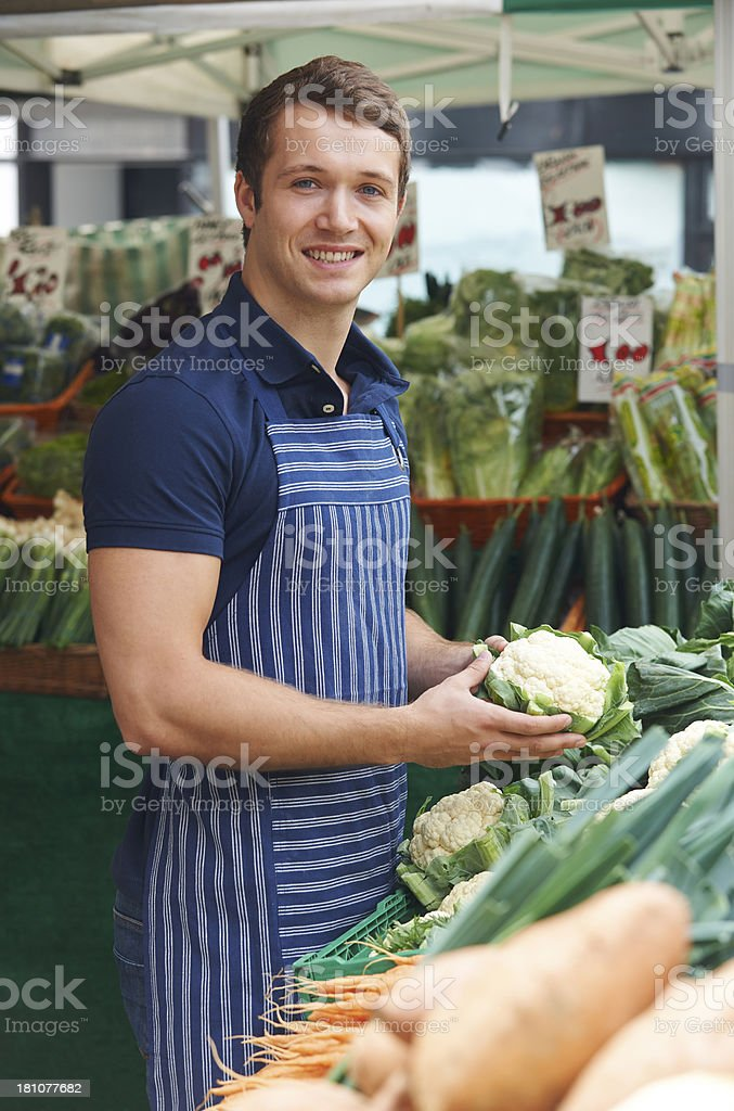 Owner Of Market Vegetable Stall royalty-free stock photo