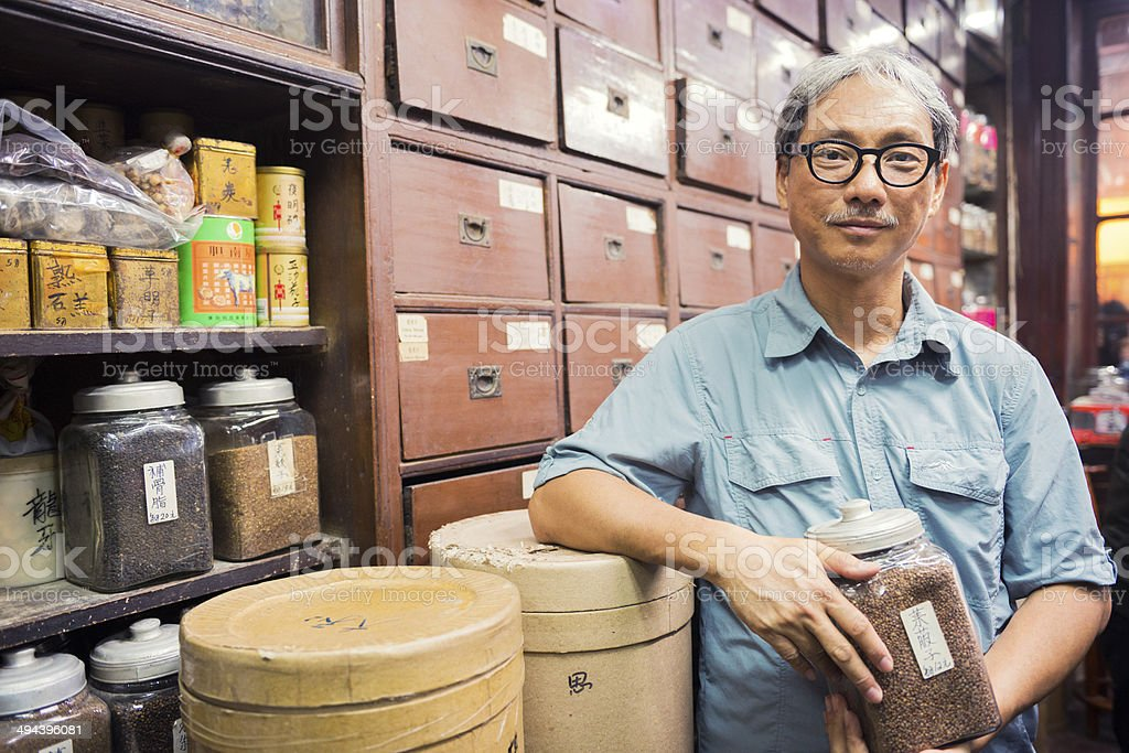Owner of Traditional Chinese Medicine Shop in Kowloon Hong Kong stock photo