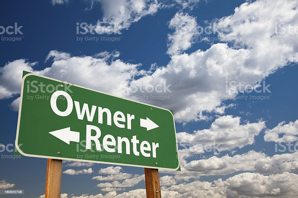 Owner, Renter Green Road Sign Over Clouds stock photo