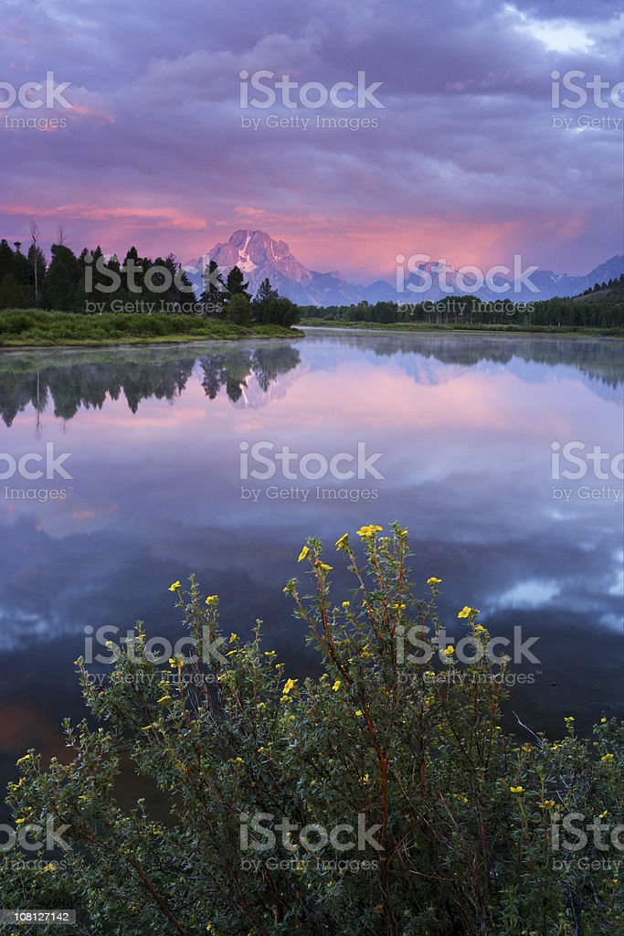 Oxbow Bend Lake with Mountains in Background at Sunset stock photo