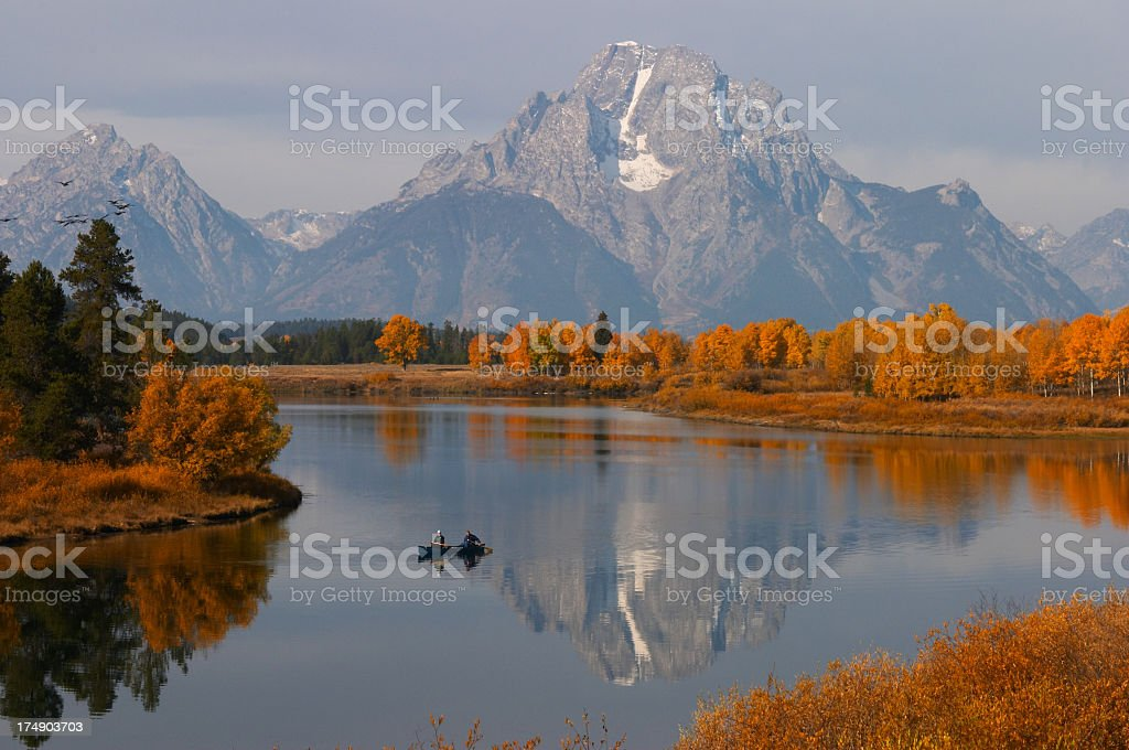 Oxbow Bend with fall color and canoe stock photo