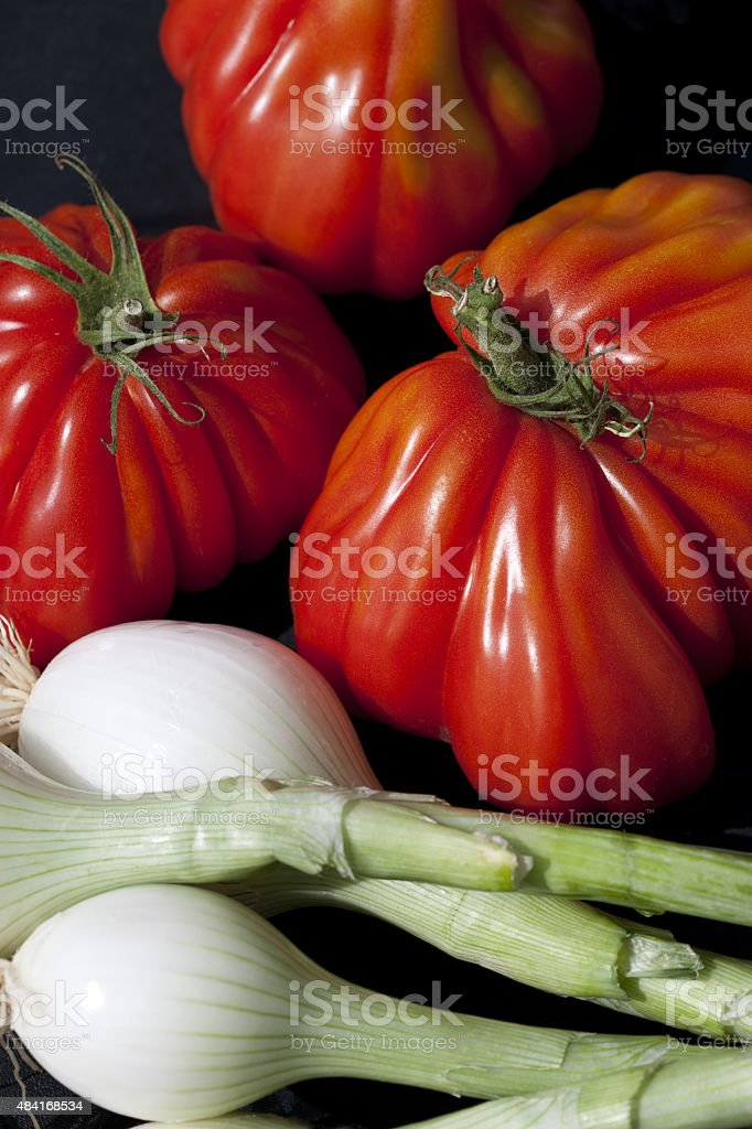 Oxheart Tomatoes and Onions stock photo