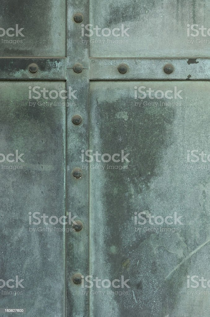 Oxidized copper background with rivets royalty-free stock photo