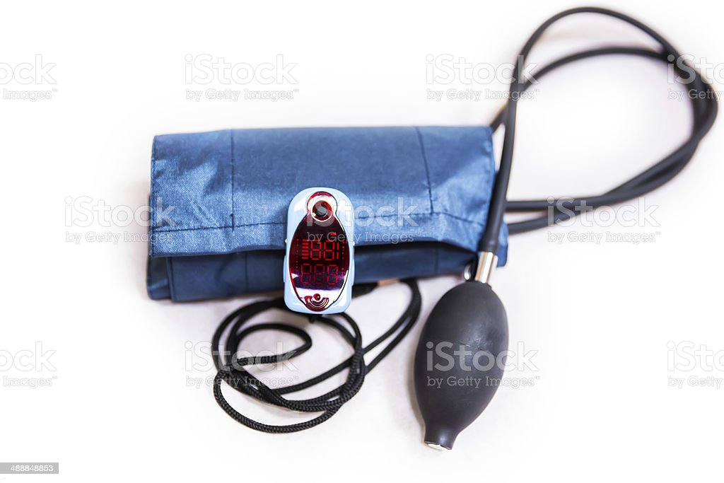 Oximeter and blood pressure cuff stock photo