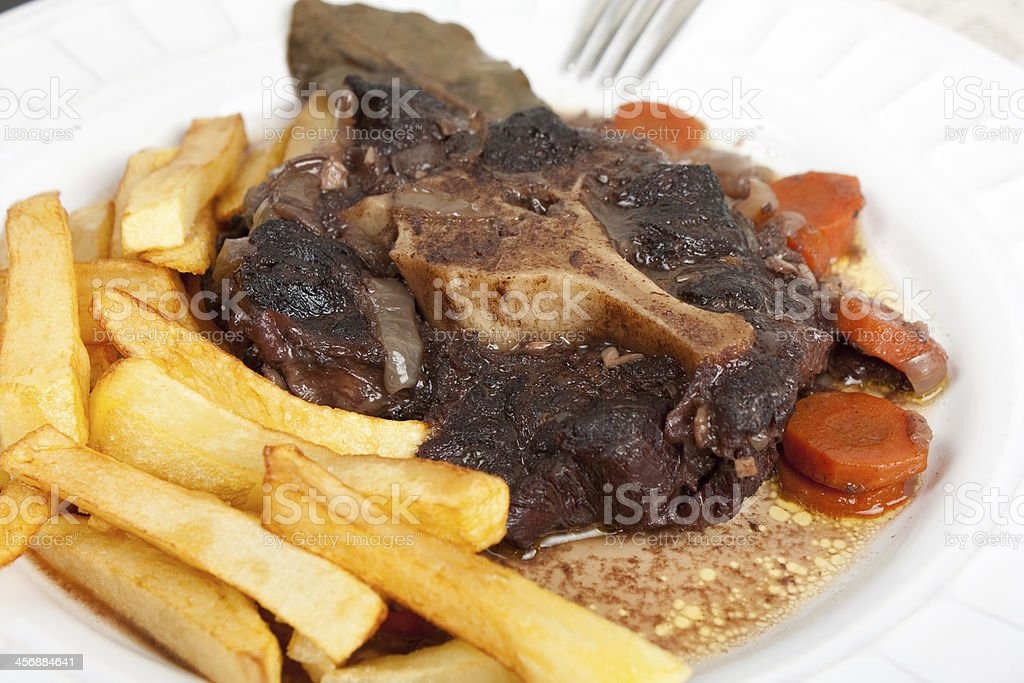 Oxtail stew with carrots and fries royalty-free stock photo