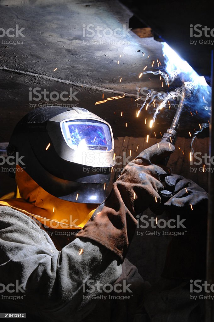 Oxy acetylene cutting resulting in a shower of sparks stock photo